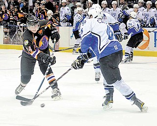 Youngstown Phantom Mike Ambrosia and the Lincoln Stars' Chris Casto fight for possession of the puck.