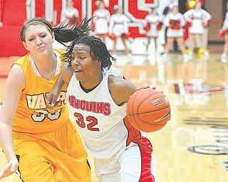 Youngstown Penguin Tieara Jones drives to the hoop and is defended by Valparaiso's Maegan Callaway.