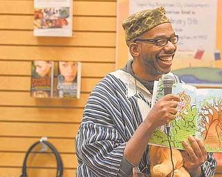 "Roland C. Barksdale-Hall reads a selection from his book ""Under African Skies"" during the African American Read-In held by the Youngstown City Schools at Barnes & Noble Booksellers in Boardman."