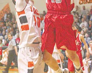 LaBrae's Peyton Aldridge (10) tries to score as  Cody Dillon (10) plays tight defense during their game Tuesday evening.