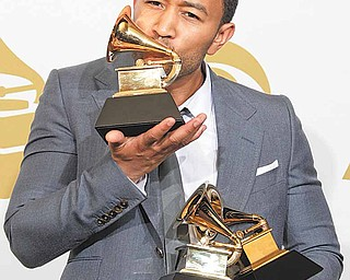 John Legend is seen backstage with the awards for best R&B album, best R&B song, and best traditional R&B vocal performance at the 53rd annual Grammy Awards on Sunday, Feb. 13, 2011, in Los Angeles.