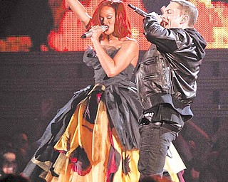 Rihanna, left, and Eminem perform at the 53rd annual Grammy Awards on Sunday, Feb. 13, 2011, in Los Angeles.