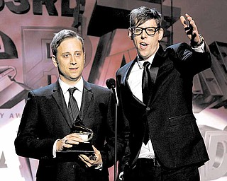 The Black Keys, Patrick Carney, right, and Dan Auerbach accept the award for best alternative music album during the pre-telecast at the 53rd annual Grammy Awards on Sunday, Feb. 13, 2011, in Los Angeles.
