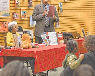 Youngstown Mayor Jay Williams reads a speech by then Senator Barack Obama at the groundbreaking of the Dr. Martin Luther King Jr. National Memorial during the African American Read-In held by the Youngstown City Schools at Barnes & Noble Booksellers in Boardman.
