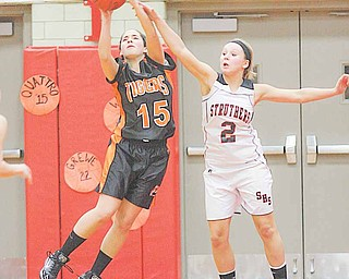 Newton Falls'  Angela Giuliano (15) and Sadie Noling (2) battle for the ball Monday night in Struthers.