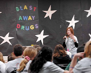 Meridian Community Care social worker, and PANDA club coordinator Beth Bonish talks to Boardman center Middle School students during a PANDA club lock-in. The lock-in was set up to discuss issues surrounding drug and alcohol use prevention as well as decision making techniques.