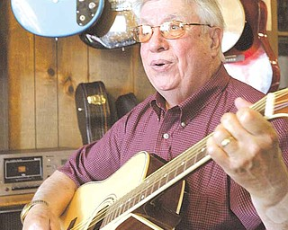 Longtime Mahoning Valley musician Rocky Chirchiglia in his Austintown muic store.