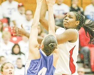 YSU's Brandi Brown shoots over IPFW's Stephanie Rosado during first half action Saturday at YSU.