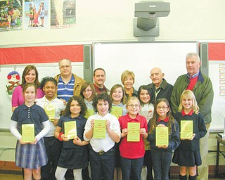 Never at a loss for words: Struthers Rotary Club is continuing its participation in the Dictionary Project by delivering dictionaries to fourth-grade students in area schools. The goal of the program is to assist all students in becoming good writers, active readers, creative thinkers and resourceful learners. The dictionaries are given as gifts for each student to use at school and at home. Joining the fourth-grade students at St. Nicholas School, Struthers, as they display their new dictionaries are, from left at back, Taylor Hair, fourth-grade teacher; and Tom Baringer, Bryan Higgins, Marge Diorio, Paul Paris and Dan Becker, Rotary members.