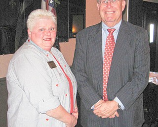 One to G.R.O.W. on: Warren Republican Women met recently at DiLucia's Banquet Center on Elm Road. Guest speaker was John Taylor, above, who represents Garden Resources of Warren, also known as G.R.O.W., a volunteer-driven organization that develops abandoned parcels of Trumbull County land into urban community gardens. The organization has eight gardens in Warren. With him is Cary Ann Koren, WRWC program chairwoman.