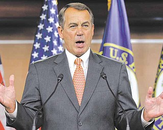 House Speaker John Boehner of Ohio gestures during a news conference on Capitol Hill in Washington on Thursday.
