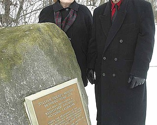 Shirley Eckley, vice-president and secretary of the William Holmes McGuffey Society, and a decedent of William Holmes McGuffey and Richard Scarsella stand hear a plaque at the William Homes McGuffey Wildlife preserve on McGuffey Road.