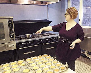 Charlene Crissman, administrator and part-owner of House of Hope, stands in the kitchen of her facility in Youngstown.