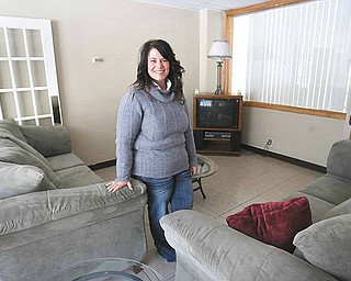 Michelle Beauchene, director of Hannah's House, stands in the Vienna township facility's living area.