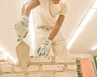 Russell Gibson, an 11th grader from Chaney, works on building a wall as part of a contest for tech students in Ohio.