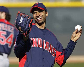 Cleveland Indians relief pitcher Rafael Perez laughs during warmups at baseball spring training practice Thursday, Feb. 17, 2011, in Goodyear, Ariz.