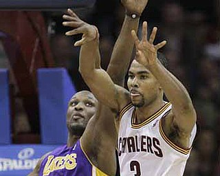 Cleveland Cavaliers' Ramon Sessions (3) passes the ball under pressure from Los Angeles Lakers' Lamar Odom (7) in the fourth quarter of an NBA basketball game in Cleveland on Wednesday, Feb. 16, 2011. The Cavaliers won 104-99.