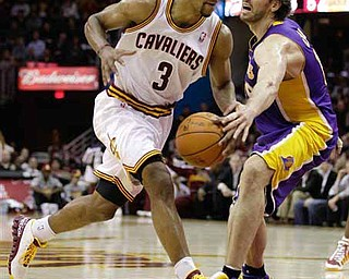 Cleveland Cavaliers' Ramon Sessions (3) drives to the basket against Los Angeles Lakers' Pau Gasol in the second half of an NBA basketball game in Cleveland on Wednesday, Feb. 16, 2011. The Cavaliers won 104-99.