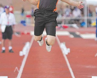 Dan Skiba, of Mineral Ridge, competes in the Division III long jump event at Ohio State University's Jesse Owens Memorial Stadium. Skiba went on to finish in first place in the event.
