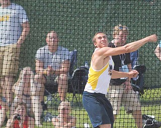 McDonald's Matthias Tayala throws the discus during Division III competition at Ohio State University's Jesse Owens Memorial Stadium. Tayala finished second place in the event.