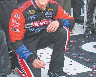 Trevor Bayne signs his name into cement in Victory Lane after winning the Daytona 500 at Daytona International Speedway in Daytona Beach, Florida, Sunday, February 20, 2011.