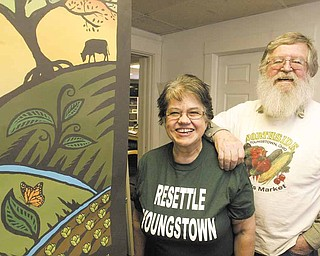 Jim Converse, manager of the Northside Farmer's Market, and his wife, Pat Rosenthal, announced plans to turn the former Penguin Pub, on 901 Elm St., into a fresh produce store. The store also will serve as the Northeast Ohio Food Hub.
