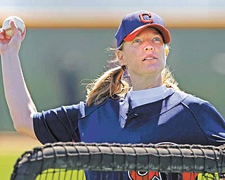 Justine Siegal throws batting practice to Cleveland Indians catchers during baseball spring training, Monday, Feb. 21, 2011, in Goodyear, Ariz. Siegal became the first woman to pitch batting practice at a Major League camp.