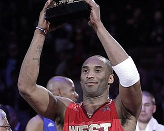 West's Kobe Bryant holds up the MVP trophy after the NBA basketball All-Star Game in Los Angeles, Sunday, Feb. 20, 2011. The West won 148-143.