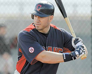 Cleveland Indians' Travis Hafner stands in against live pitching during baseball spring training Monday, Feb. 21, 2011, in Goodyear, Ariz.