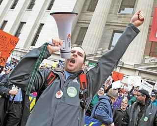 Jason Petroff, of Chardon, leads cheers during a protest against Senate Bill 5 outside the Ohio Statehouse, Tuesday, Feb. 22, 2011, in Columbus, Ohio.