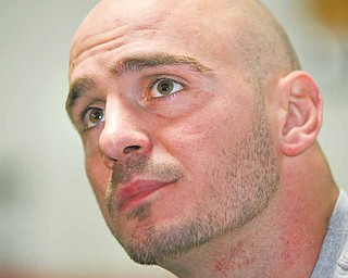 Boxer Kelly Pavlik talks to the media Tuesday at Jack Loews Southside Boxing Club.