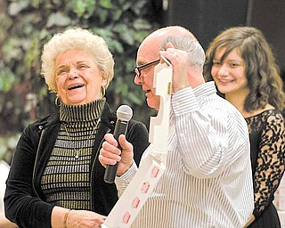 "Joseph Seminara of the local Pizza Joe's restaurant chain announces that Barb Kuras of Boardman, left, won a year's worth of pizza at the Thrill or No Thrill fundraiser for the United Way of Youngstown and the Mahoning Valley. Seminara was the master of ceremonies for Wednesday's fundraiser, based on the TV show ""Deal or No Deal,"" at Our Lady of Mount Carmel hall in Youngstown."