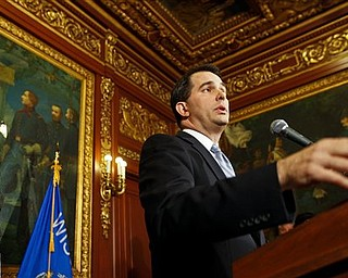 Wisconsin Gov. Scott Walker talks to the media at the state Capitol in Madison, Wis., Wednesday, Feb. 23, 2011. Opponents to the governor's proposal to eliminate collective bargaining rights for many state workers are in their ninth day of protests at the Capitol.  (AP Photo/Andy Manis)