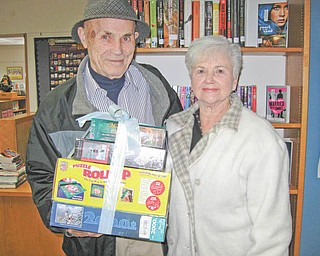 "Jigsaw puzzles exchanged: Newton Falls Public Library, 204 S. Canal St., encouraged residents to take part in its annual Jigsaw Puzzle Exchange recently at the library. New or gently used jigsaw puzzles were taken to the library, then those donating puzzles later returned to the library to select ""new to you"" puzzles. The winner of a drawing at the exchange was George Chepke, above. He and his wife, Pat, picked up the three puzzles and puzzle mat he won at the event."