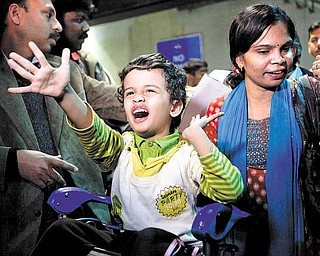 An Indian family who were in Libya arrive after being evacuated from Tripoli, because of the ongoing strife, at Indira Gandhi International airport, in New Delhi, India, Sunday, Feb. 27, 2011. The first batch of nearly 300 Indians evacuated from strife-torn Libya landed in New Delhi aboard a special Air India flight close to midnight Saturday. Meanwhile, three Indian Navy ships have also sailed to Libya to help in the evacuation of the 18,000 Indians in the country, according to news reports.