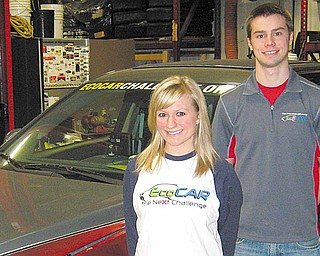 Abby Underwood, a Braceville native, and Ryan Everett of Canfield are part of Ohio State University's EcoCAR: The NeXt Challange team to produce a fuel-efficient vehicle.
