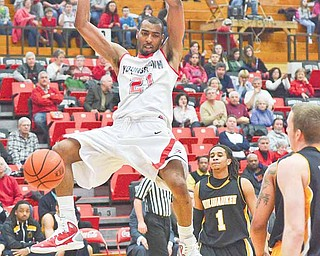 Youngstown State's Damian Eargle (21) dunks and scores against Milwaukee at the YSU Beeghly Center Saturday afternoon.