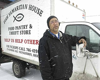 Clarence Thigpen, director of Fish Samaritan House in Youngstown, stands next to the agency's 1999 Chevrolet 3500. The truck has more than 172, 000 miles and is on its last leg.