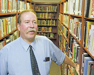 Retiring Fitch High School media teacher Harold Wilson in the school's media center. Wilson is calling quits after 37 years in the Austintown district.