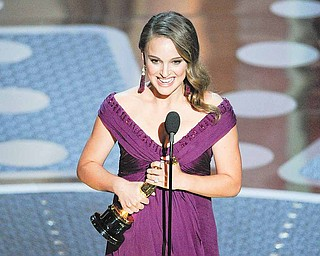 "Natalie Portman accepts the Oscar for best performance by an actress in a leading role for ""Black Swan"" at the 83rd Academy Awards on Sunday, Feb. 27, 2011, in the Hollywood section of Los Angeles."