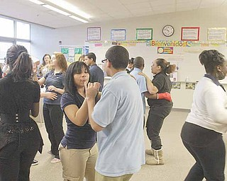 East High School students cut a rug in a classroom in preparation for Friday's Quinceanera at the school. A Quinceanera celebrates a girl's maturity into a young lady.