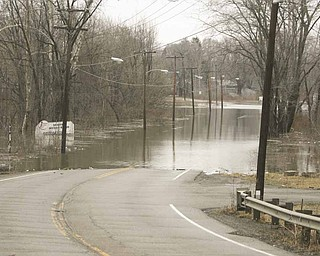 Flooding on state Route 46 and McKees Lane in Weathersfield Township in Trumbull County caused the road to be closed to traffic for several hours Monday.