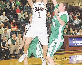 Salem's Ryan Bush (1)  shoots past the defense of Matt Latham (44) and Luke Butcher (2) during their game Monday night in Boardman.