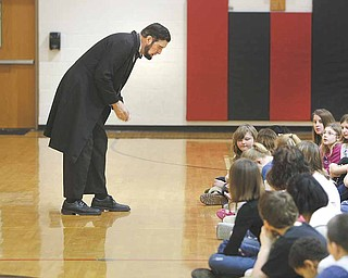 "Abraham Lincoln, as portrayed by Gerald Payn of Wooster, engages fifth-graders at Girard Intermediate School during a presentation Monday. Greg Bonamase, principal, said the enrichment program ""is designed to bring history alive."""