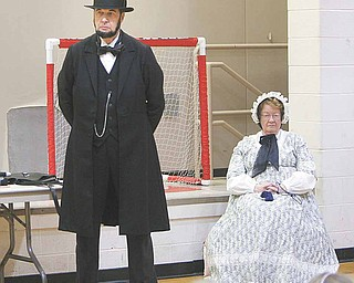 Gerald Payn looks the part of Abraham Lincoln dressed in a long black suit coat and trousers along with the trademark top hat. His wife, Marilyn, plays the part of Lincoln's spouse, Mary Todd. Payn portrayed the 16th president for students at Girard Intermediate School Monday.