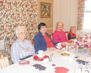 Young at heart: Residents of the Century House of Salem celebrated Valentine's Day with a special dinner served to each resident on their own Valentine heart plate, along with a heart of chocolates. Activities for the residents' enjoyment included Valentine games, stories and riddles. In the afternoon the residents also were treated to a hand massage for their relaxation while enjoying the warmth of the home's Valentine tree. Participating in some of the activities were, from left, Ruby Schnurrenberger, Ann Dzik, Grace Donohue and Mary Beard.