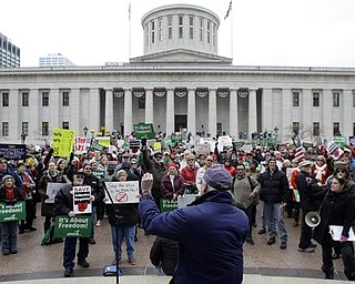 Protestors in opposition of Senate Bill 5 gather at the Ohio Statehouse, Saturday, Feb. 26, 2011, in Columbus, Ohio. The bill would strip public employees of collective bargaining rights.