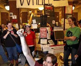 Jordan Peterson celebrates after it was announced protesters could spend another night at the state Capitol in Madison, Wis., Sunday, Feb. 27, 2011, on the 13th day of protests over the governor's proposed budget.