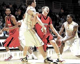 Youngstown State's forward Vytas Sulskis (#44) runs into Valparaiso Crusaders forward Kevin Van Wijk (#55) during the game Tuesday night at the Athletics and Recreation Center, Valparaiso, Indiana as the Valparaiso Crusaders hosted the Horizon League Tournament against Youngstown State.