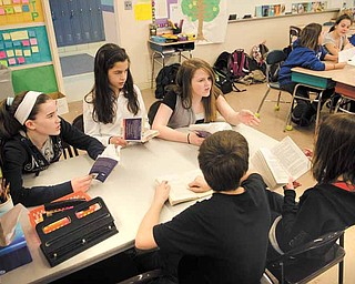 At McKinley Elementary in Poland, Eva Sullivan's sixth-grade students meet in groups where they are given a choice of what to read and discuss among peers. Sullivan said the practice increases the number of books students read each year.